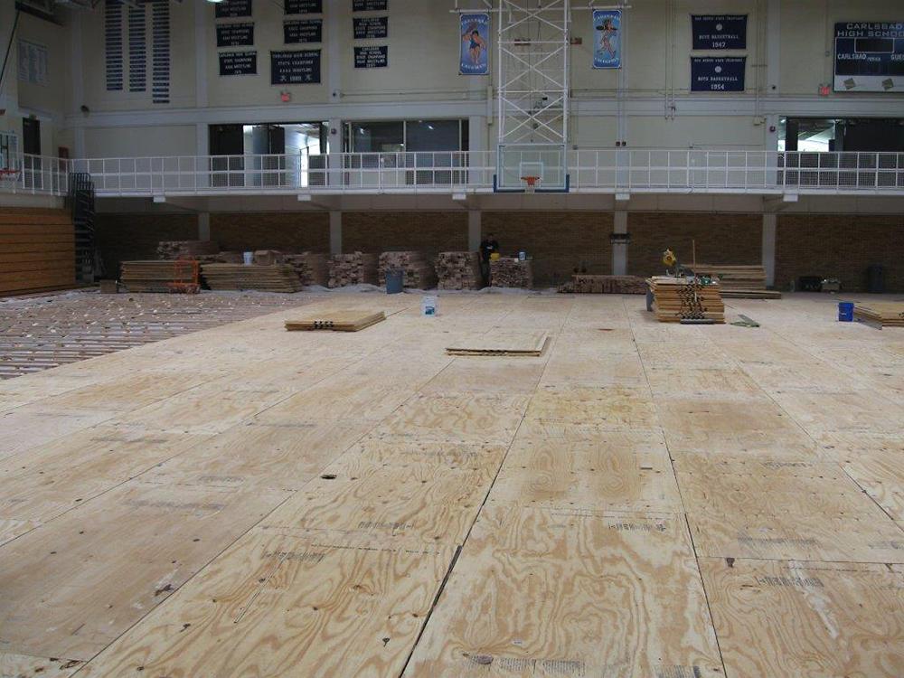 Carlsbad cavemen high school gym benchmark woodfloors for Hardwood floors albuquerque